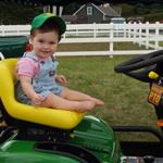 Gracie Nourse on the raffle tractor